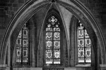 A black and white gothic interior with stained glass windows in the Gothic Quarter of Barcelona, Spain