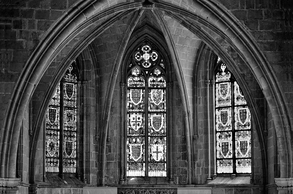 A Black And White Gothic Interior With Stained Glass Windows In The Quarter Of Barcelona