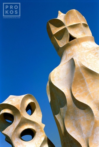 A fine art architectural photo of the Modernist chimneys designed by Antoni Gaudi on the rooftop of the Casa Mila (La Pedrera), Barcelona, Spain