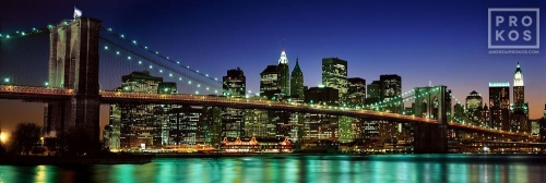 A high-definition panoramic skyline photo of the Brooklyn Bridge and Lower Manhattan at night, New York City