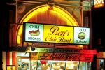 A street scene photo of Ben's Chili Bowl restaurant at night, Washington DC
