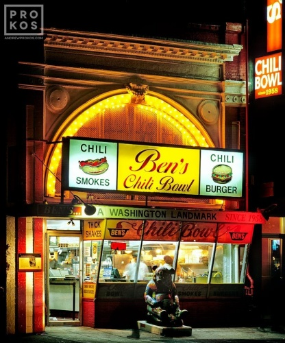 A street scene photo of Ben's Chili Bowl restaurant at night, Washington DC