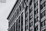 An architectural photo of the facades of the buildings along Broadway in Downtown Manhattan in black and white