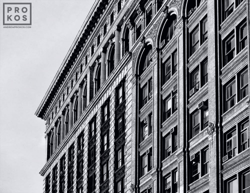 Facades of the buildings along Broadway in Downtown Manhattan in black and white