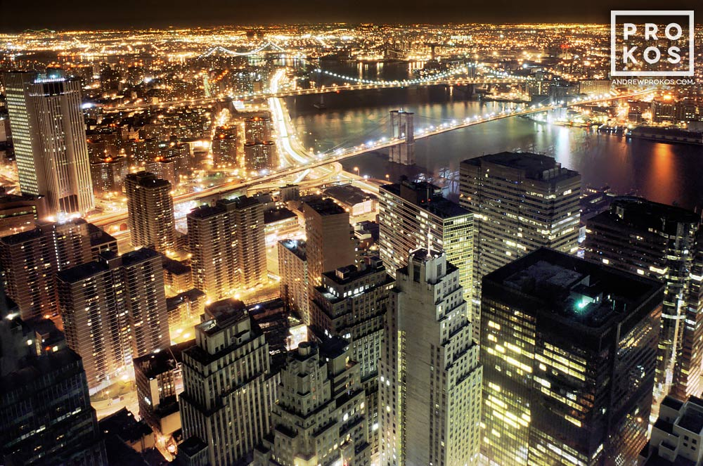 An aerial view of Lower Manhattan and the Brooklyn Bridge at night, New York City