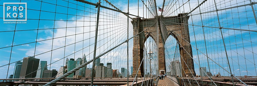 A high-definition panoramic photo of the Brooklyn Bridge's suspension cables and Lower Manhattan skyline, New York City. Large-format fine art prints of this photo are available up to 120 inches wide.