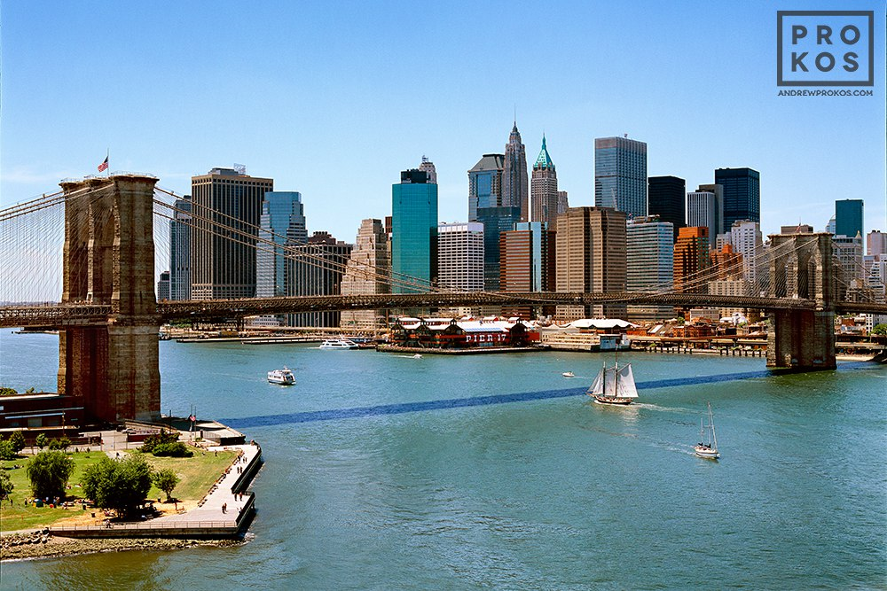 A skyline of Lower Manhattan and the Brooklyn Bridge during the day, New York City