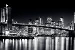 An ultra high-definition black and white skyline of the Brooklyn Bridge and Lower Manhattan at Night, New York City. Large-scale fine art prints of this photo are available up to 150 inches wide.