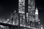 A night view of the Brooklyn Bridge and skyscrapers of Lower Manhattan in black and white, including World Trade Center and New York by Gehry
