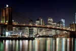 An ultra high-definition panoramic photo of the Brooklyn Bridge and Lower Manhattan skyline at night, New York City. Large-scale prints of this photo are available up to 150 inches wide.