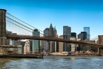 A panoramic skyline of the Brooklyn Bridge and Lower Manhattan during the day, New York City. Large format prints up to 150 inches wide are available from this ultra-high-resolution photo.
