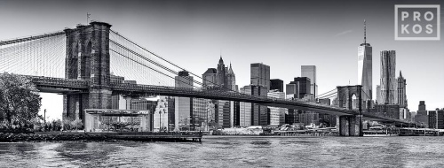 A large-format panoramic fine art photograph of the Brooklyn Bridge and Lower Manhattan skyline in black and white, New York City