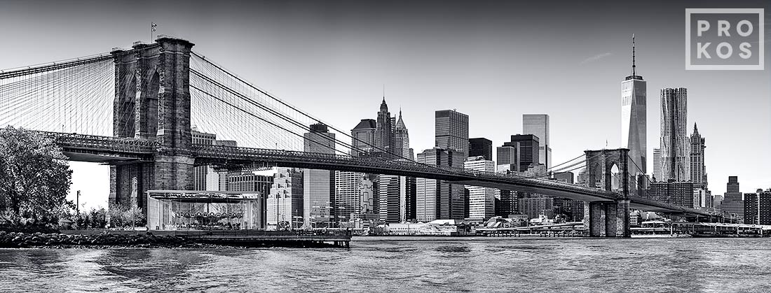 An ultra high-definition panorama of the Brooklyn Bridge and Lower Manhattan skyline in black and white, New York City. Large-scale fine art prints of this photo are available up to 150 inches wide.