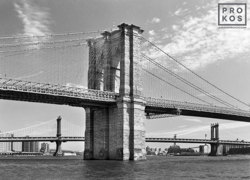 A fine art architectural photo of the Brooklyn Bridge from Manhattan in black and white, New York City