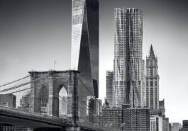 An ultra high-definition black and white photo of the Brooklyn Bridge and the skyscrapers of Lower Manhattan, including One World Trade Center and 8 Spruce Street