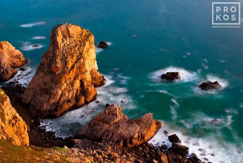 A landscape photo of the Atlantic Ocean from Cabo da Roca, the Western-most point in Portugal and Europe, at dusk