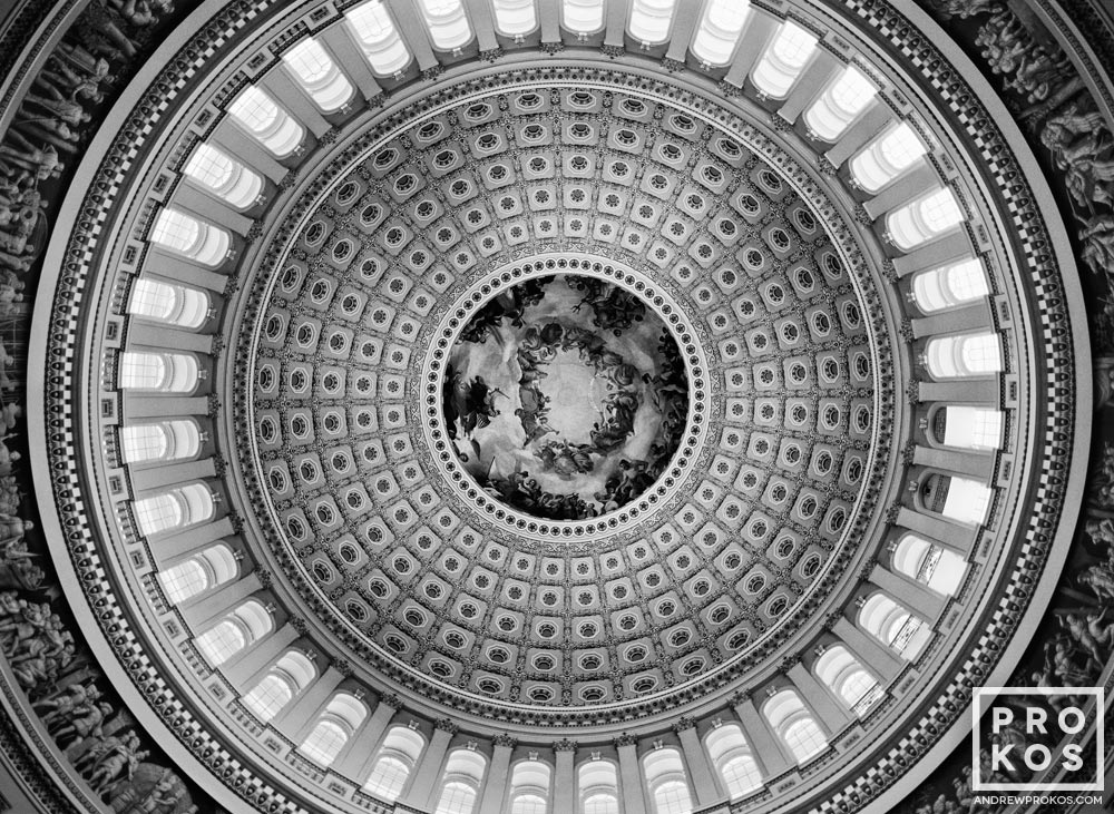 A black and white fine art architectural photo of the of the U.S. Capitol rotunda in Washington D.C.