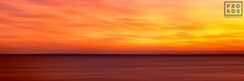A large-format panoramic seascape photo of Cape Cod, Massachussetts at sunset.
