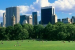 A panoramic photo of Midtown Manhattan from the lawn at Sheep's Meadow in Central Park, New York City