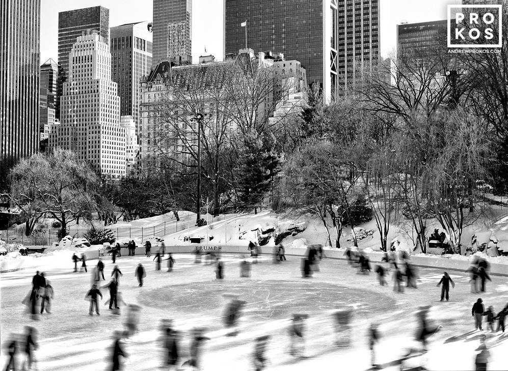 A black and white view of the ice skaters at Wollman Rink in Central Park, New York City