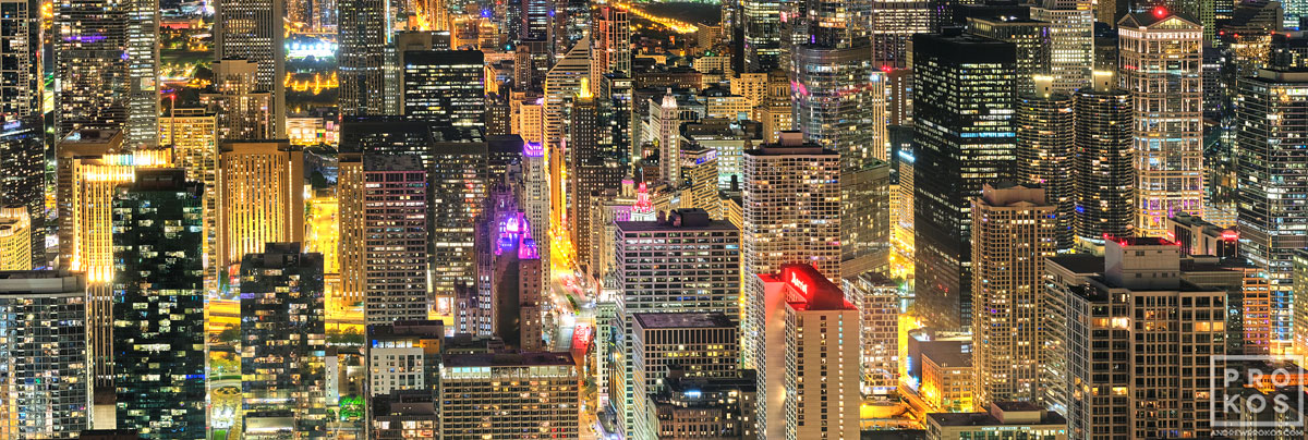 A high-definition panoramic view of the luminous skyscrapers of Chicago at night with city lights. Available as large-scale limited edition prints 90 inches in width.