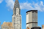 A color photo of the Chrysler Building, Met Life Building and Midtown Manhattan skyline during the day, New York City