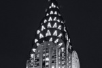 A black and white fine art photo of the illuminated spire of the Chrysler Building at night