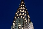 A photograph of the Chrysler Building's illuminated spire at night, New York City.
