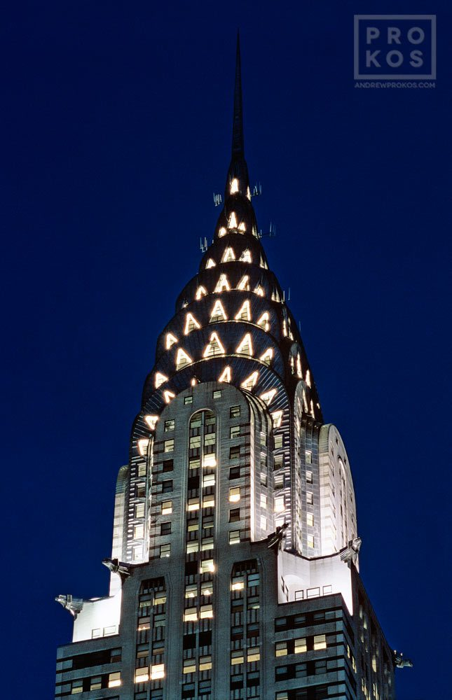 A photograph of the Chrysler Building's illuminated spire at night, New York City. Framed fine art prints of this photo are available in various styles.