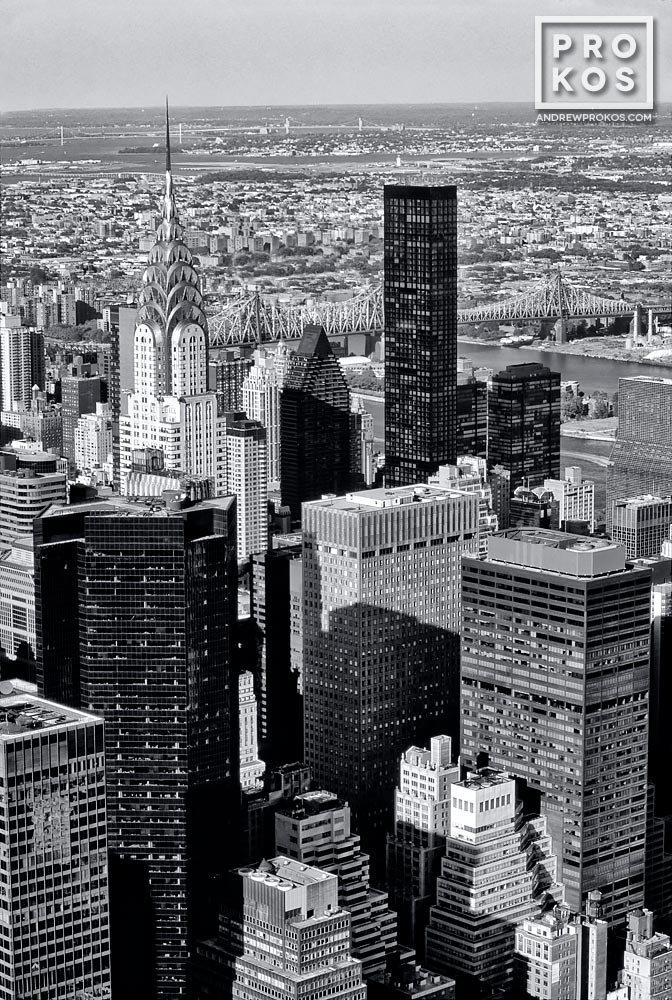 A black and white view of Midtown Manhattan and the spire of the Chrysler Building from the top of the Empire State Building, New York City