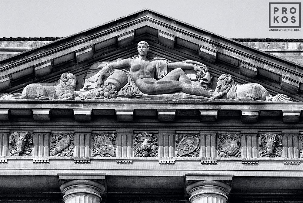 An architectural detail photo from the pediment of the US Department of Commerce building in black and white, Washington DC