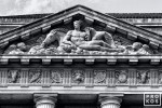 A black and white architectural detail photo of the pediment of the US Department of Commerce building in Washington DC