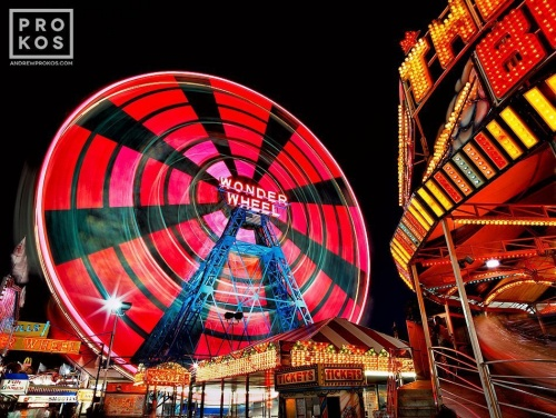 A high-definition long-exposure photo of Coney Island's Wonder Wheel ferris wheel at night in Brooklyn, New York