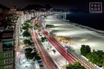 A high-definition long-exposure photograph of Rio de Janeiro's Copacabana beach at night