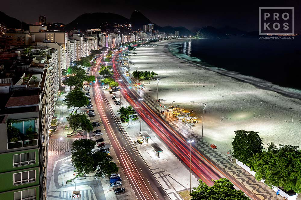 A high-definition long-exposure photograph of Rio de Janeiro's Copacabana beach at night.