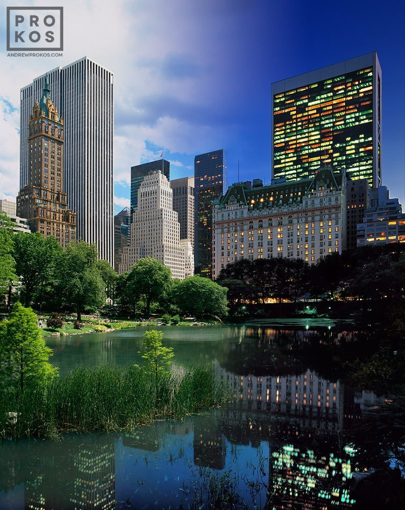 A high-definition photo of the Plaza Hotel and Pond in New York's Central Park transitioning from day to night, from Andrew's 'Night & Day' series