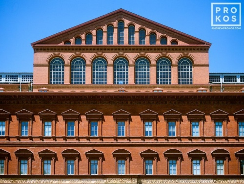 A fine art architectural photo of the red brick facade of the National Building Museum, Washington DC