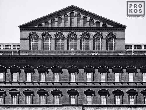 A black and white architectural photo of the brick facade of the National Building Museum in Washington DC