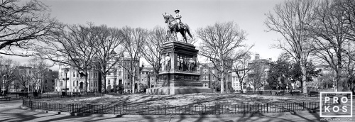 A large-format panoramic landscape photo of Logan Circle in Washington DC in black and white
