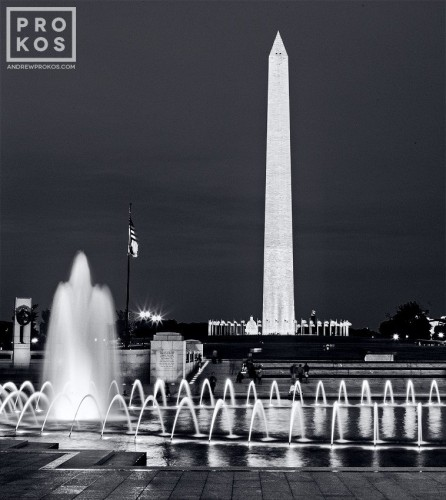 A black and white long-exposure photo of the Washington Monument from the World War II Memorial at Night, Washington, DC