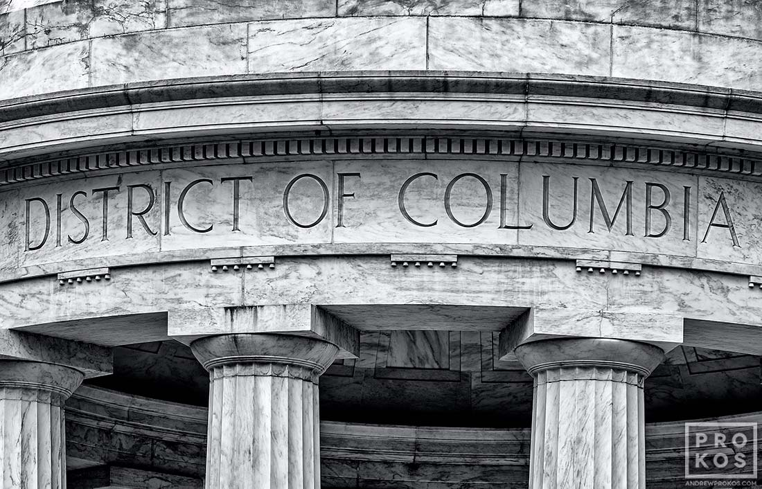 "A black and white architectural detail with inscription ""District of Columbia"" from the World War I Memorial, Washington DC"