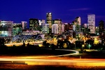 A panoramic skyline photo of Denver, Colorado at dusk