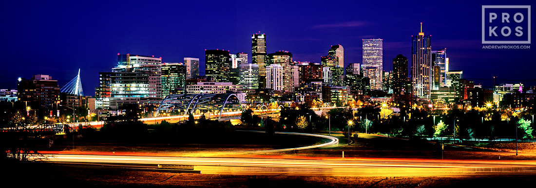 An ultra high-definition panoramic skyline photo of Denver, Colorado at dusk taken with a long exposure.