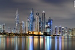 A long-exposure photo of the colorful skyline Dubai Marina at night, United Arab Emirates.