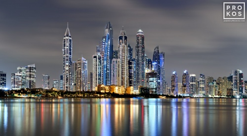 A long-exposure photo of the colorful skyline Dubai Marina at night, United Arab Emirates.