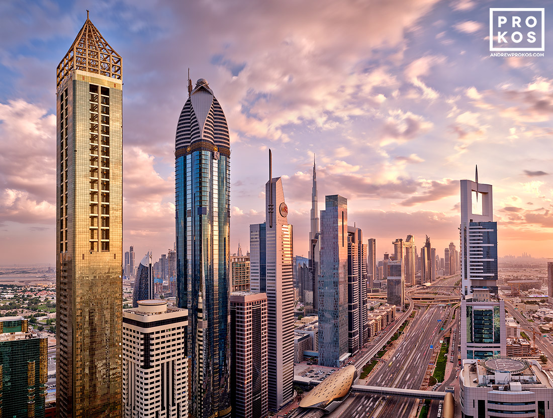 A view of the towers along Sheikh Zayed Road at sunset, Dubai, UAE. High-definition fine art prints of this photo are available up to 90 inches in width.