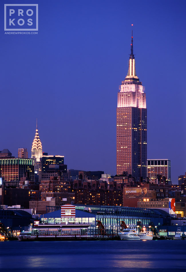 A view of The Empire State Building and Hudson River at dusk, New York City