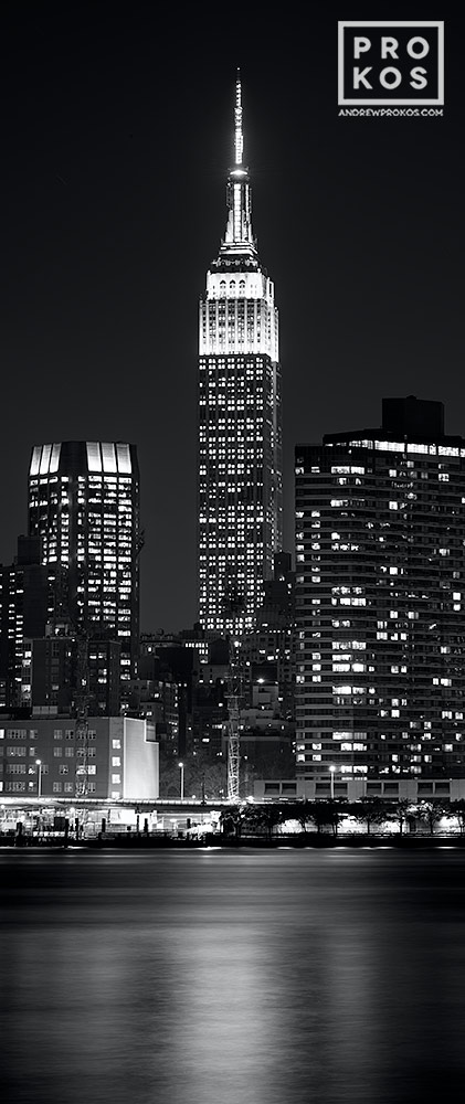 An ultra high-definition vertical cityscape photo of the Empire State Building at night in black and white, New York City. Large-format prints of this photo are available up to 72 inches in height.