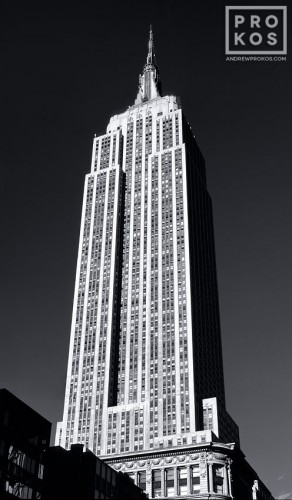 A vertical architectural panorama of the Empire State Building in black and white, New York City