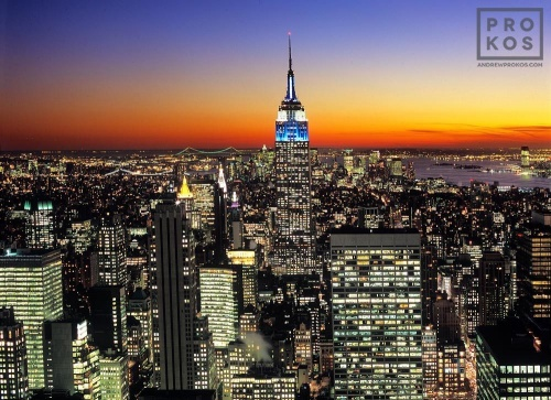 A view of the Empire State Building from Rockefeller Center at dusk.